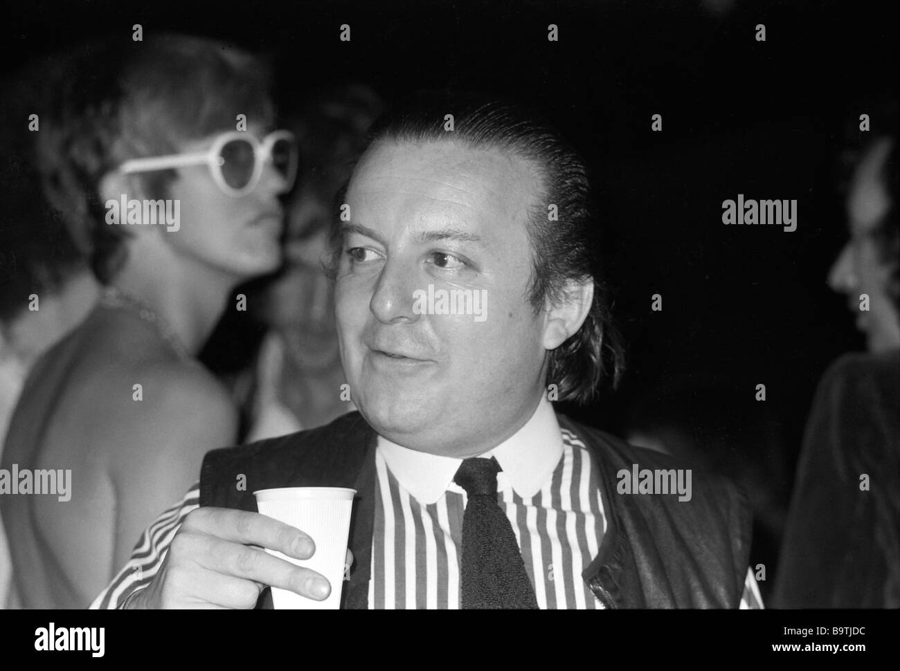 Architect Cedric Price casting a glance at the ICA  with Janet Street-Porter in the background London UK 1972   - Stock Image