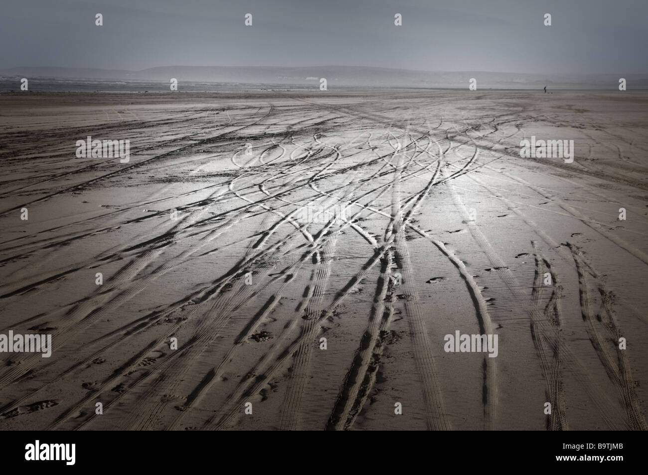 tracks in the sand (manipulated) - Stock Image