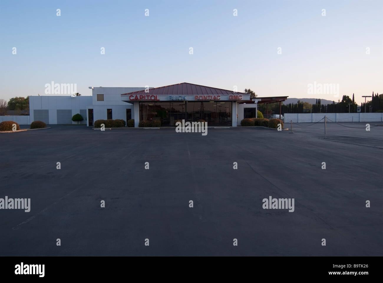 Empty Showroom of a Closed Buick Pontiac GMC Dealership in San Jose, CA. - Stock Image