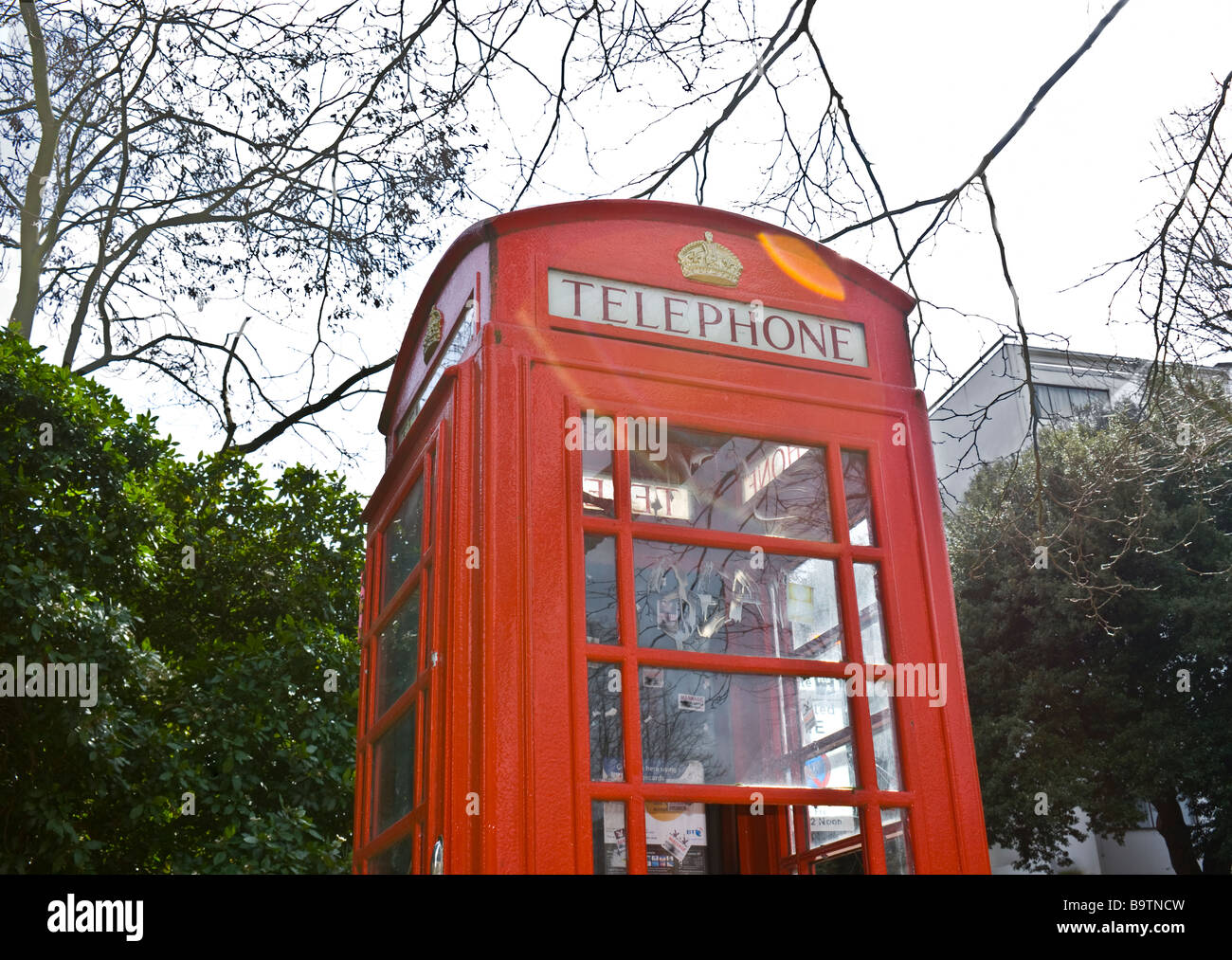 Traditional old red telephone box still in operation in Highgate North London. - Stock Image