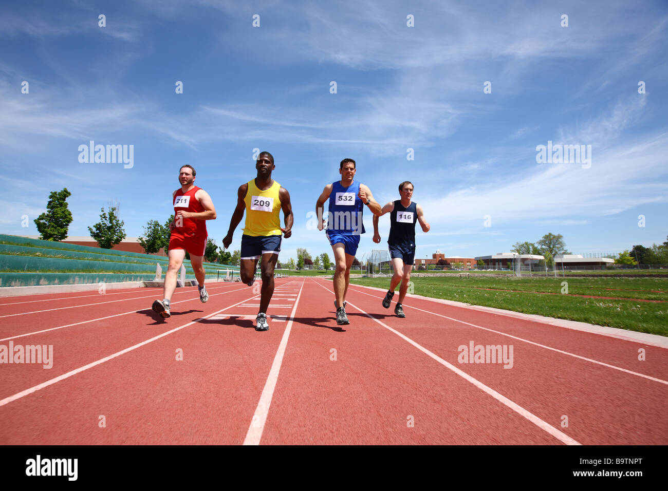 Track runners in race - Stock Image