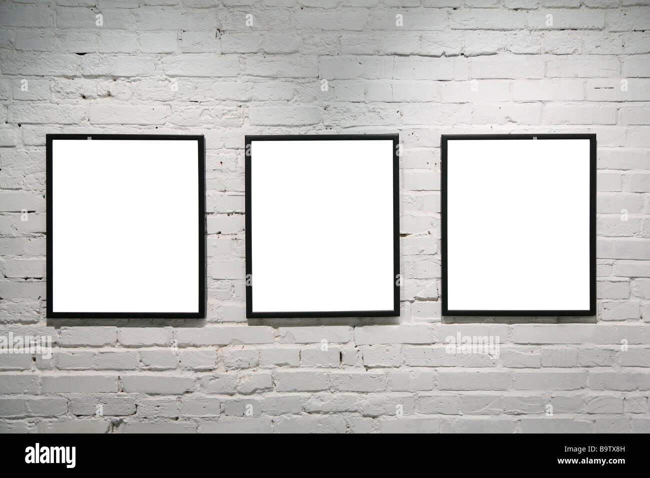 black frames on white brick wall 3 Stock Photo: 23289745 - Alamy