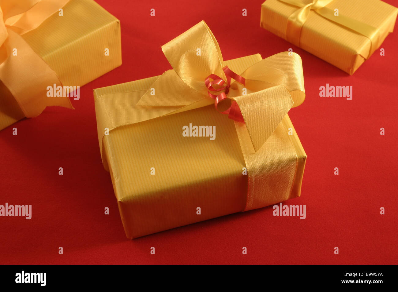 Bright Christmas Decoration Of Wrapped Parcels Against A Light Wooden Wall Birthday Gifts