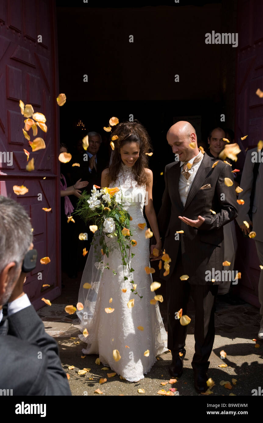 Rose petals thrown over bride and groom outside church wedding marriage Rennes Brittany France Europe Stock Photo