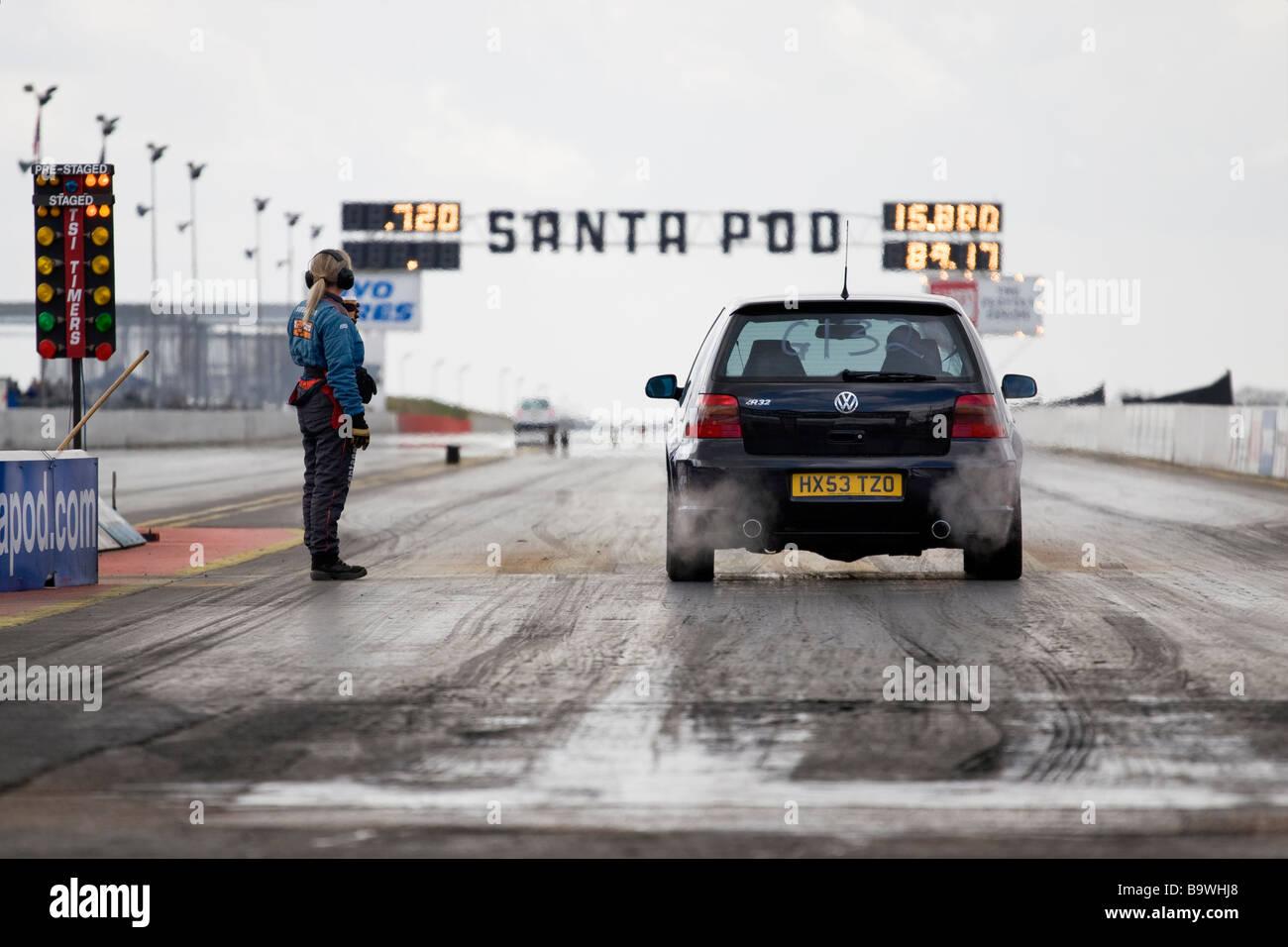 A Mk4 VW Golf R32 waits on the start line of the quarter mile drag strip at Santa Pod - Stock Image
