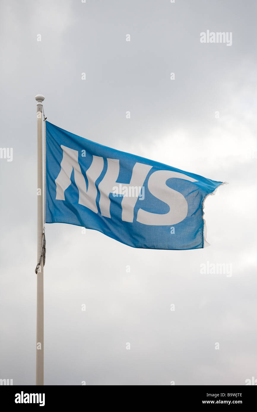 Flag of the National Health Service (NHS) flying outside a UK hospital - Stock Image