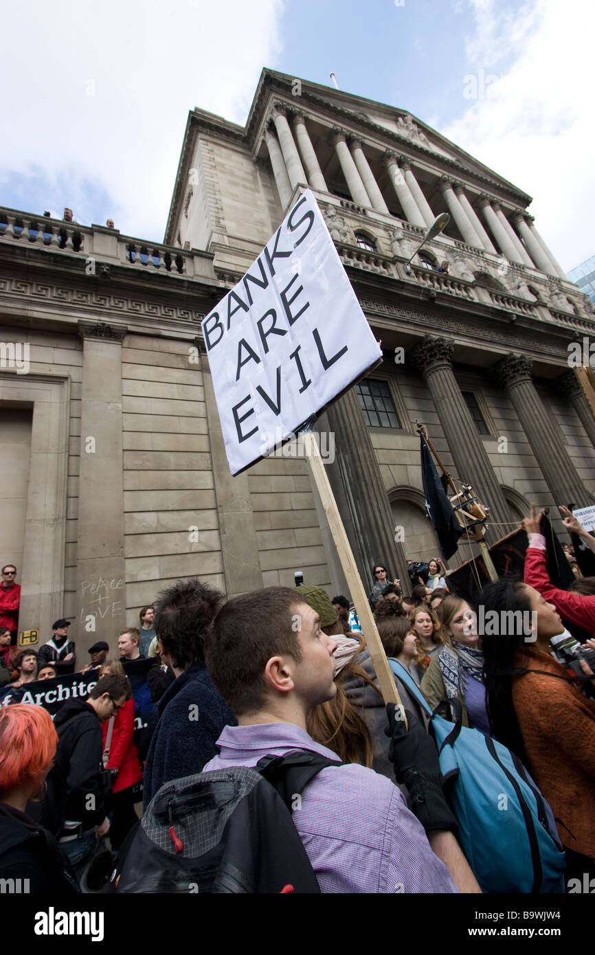 G20 demonstration London banks are evil placard outside the bank of england - Stock Image