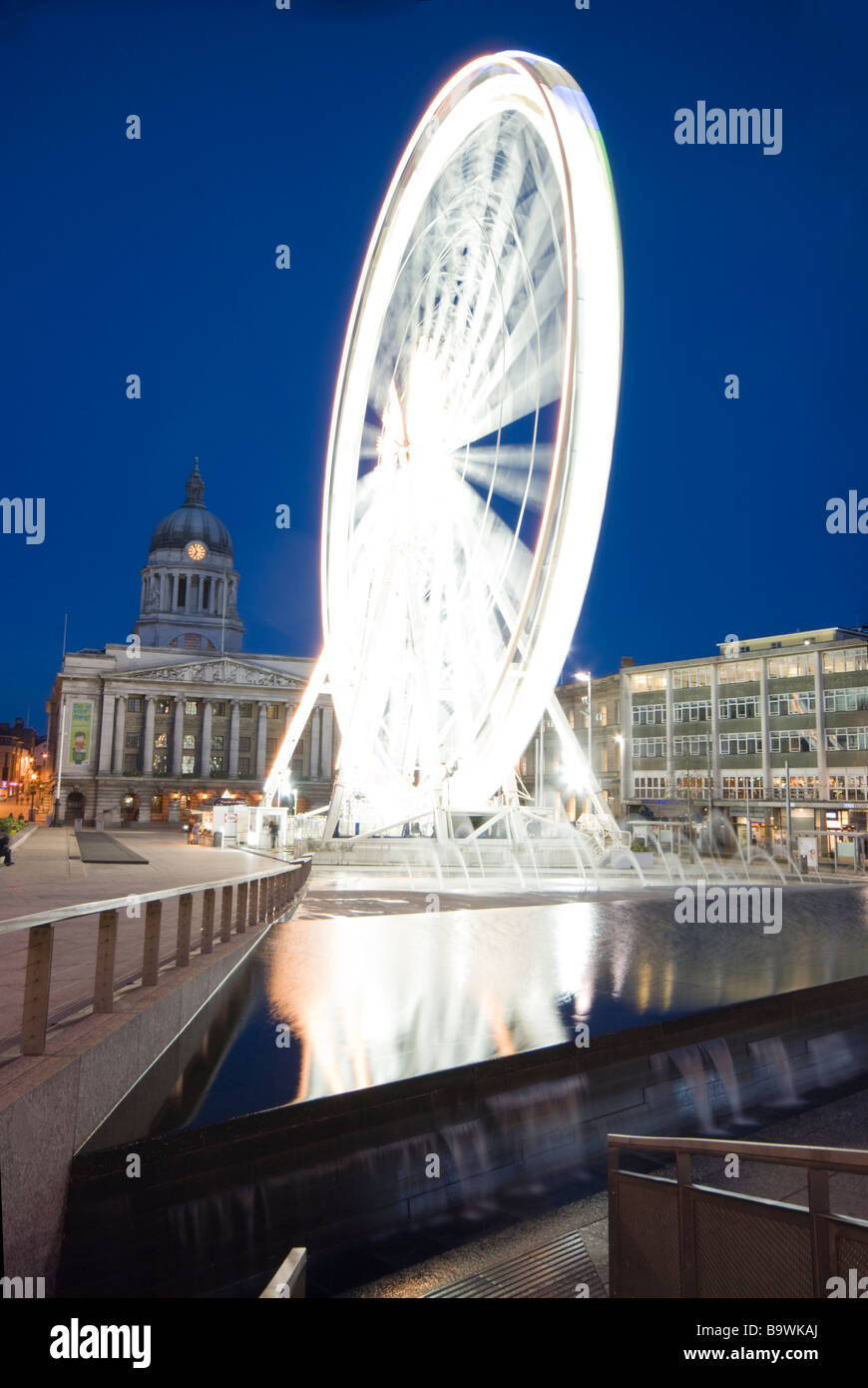 Nottingham city centre, with the Nottingham eye against the night sky. - Stock Image