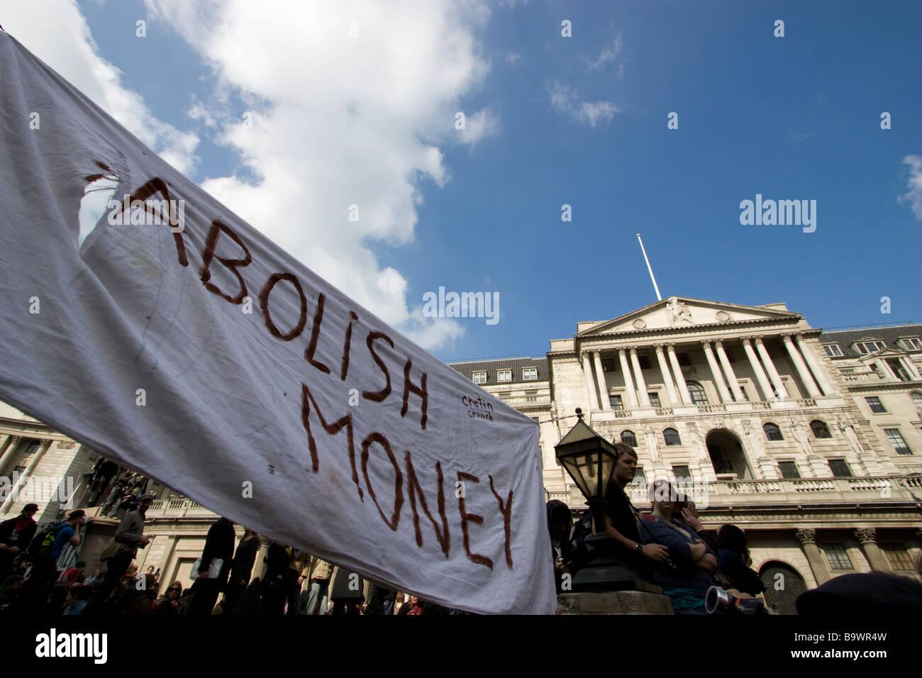 G20 demonstration London with abolish money banner outside bank of england - Stock Image