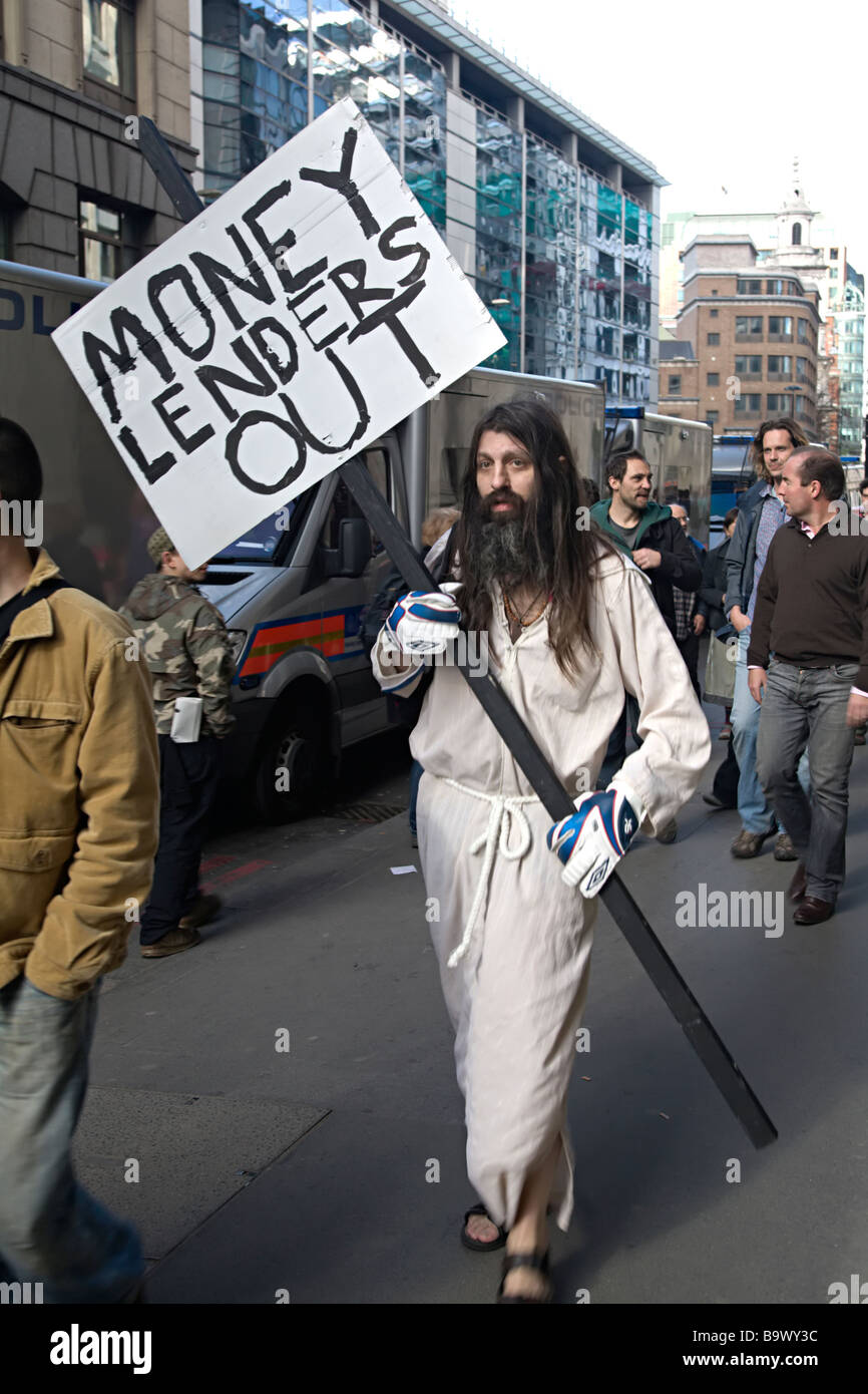 G20 anticapitalist protester dressed as Jesus with placard saying 'money lenders out', London UK 2009 - Stock Image