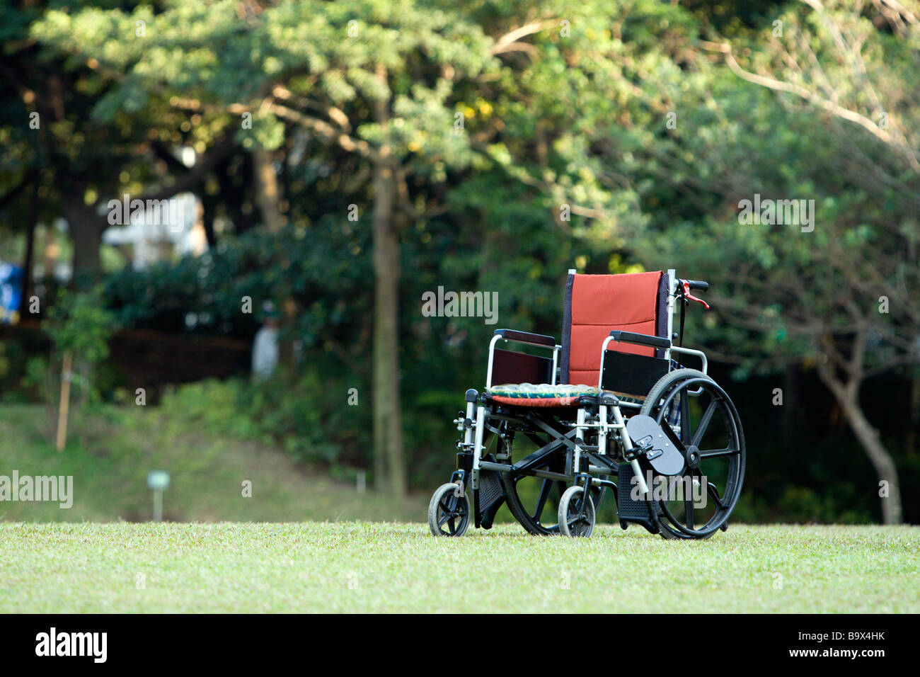 Empty wheelchair parked in park, health care concept, Taiwan Stock Photo