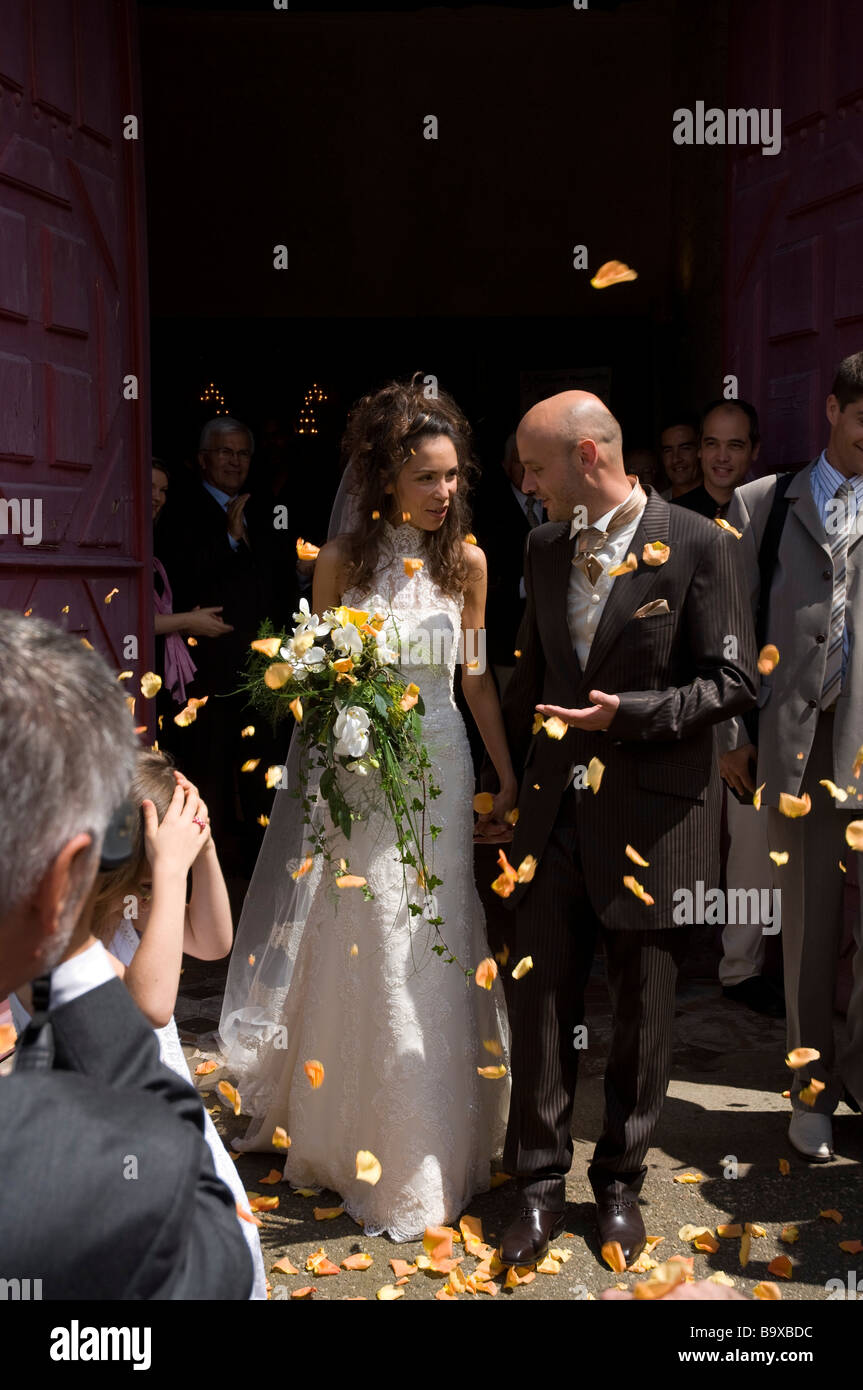 Rose petals thrown over bride and groom outside church wedding marriage Rennes Brittany France Europe - Stock Image
