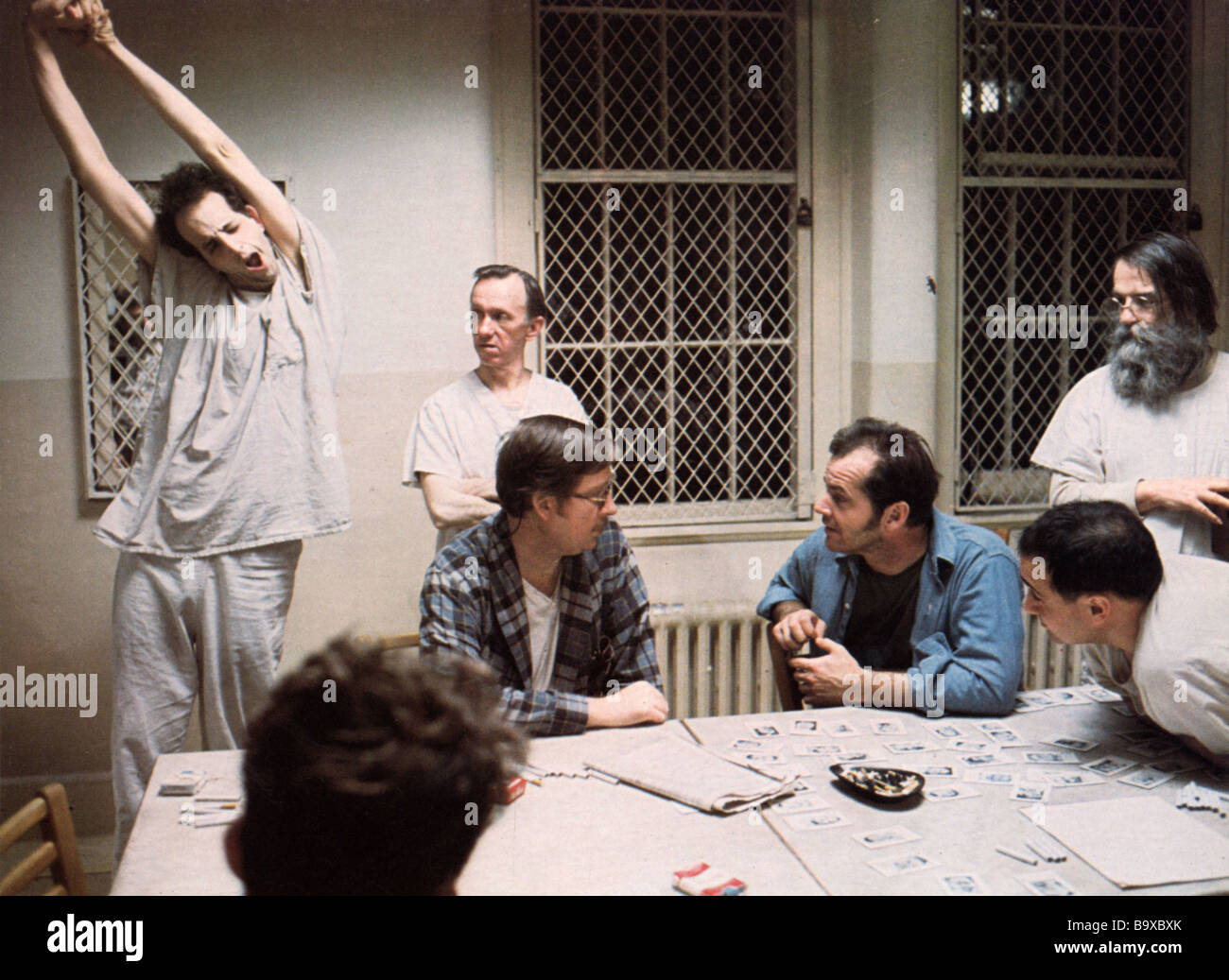 ONE FLEW OVER THE CUCKOO'S NEST 1975 UA film with Jack Nicholson seated in blue shirt - Stock Image