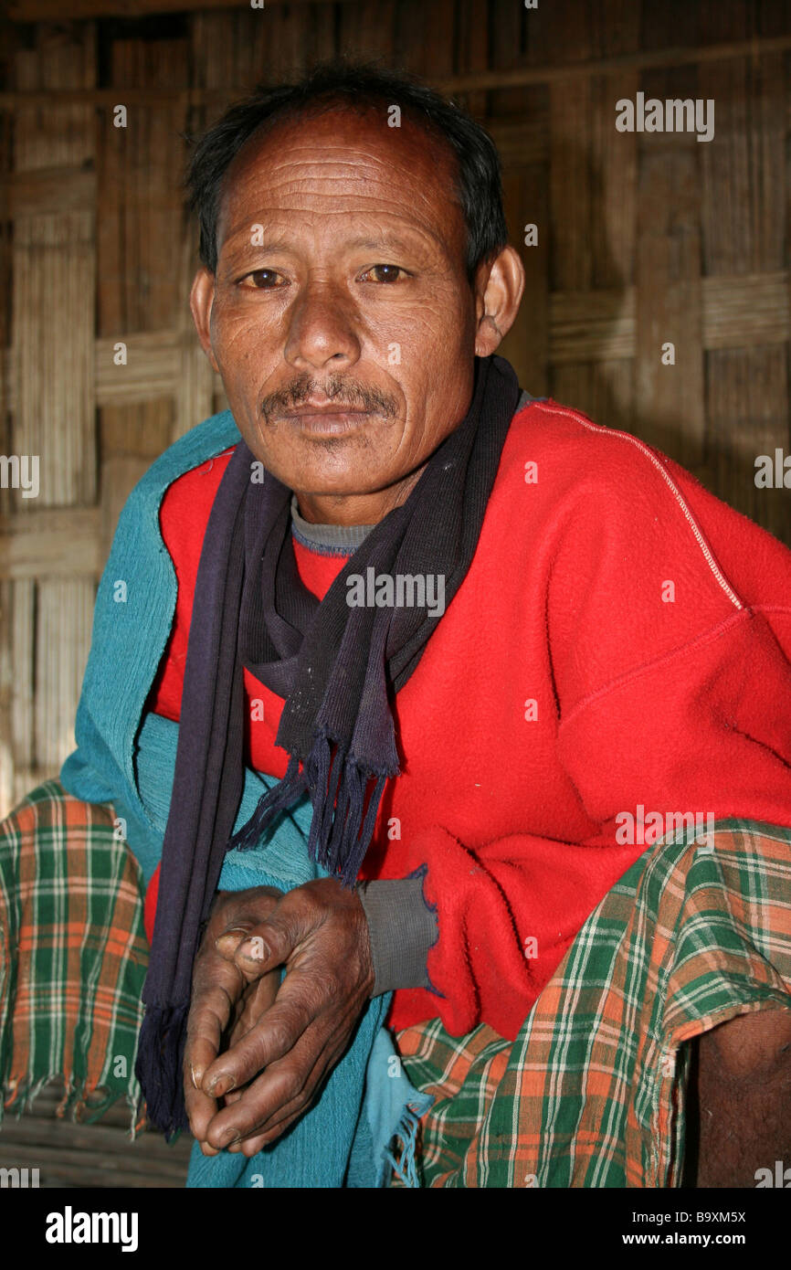 Portrait of a Mishing Tribe Man in Traditional Dress - Stock Image