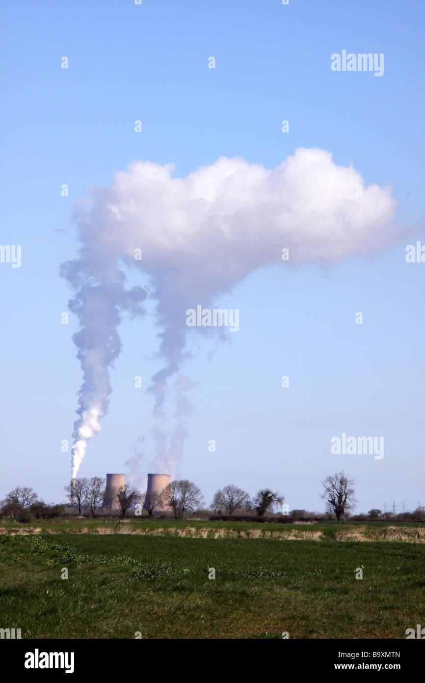 plumes of smoke or water vapour coming from a power station on the banks of the river trent - Stock Image