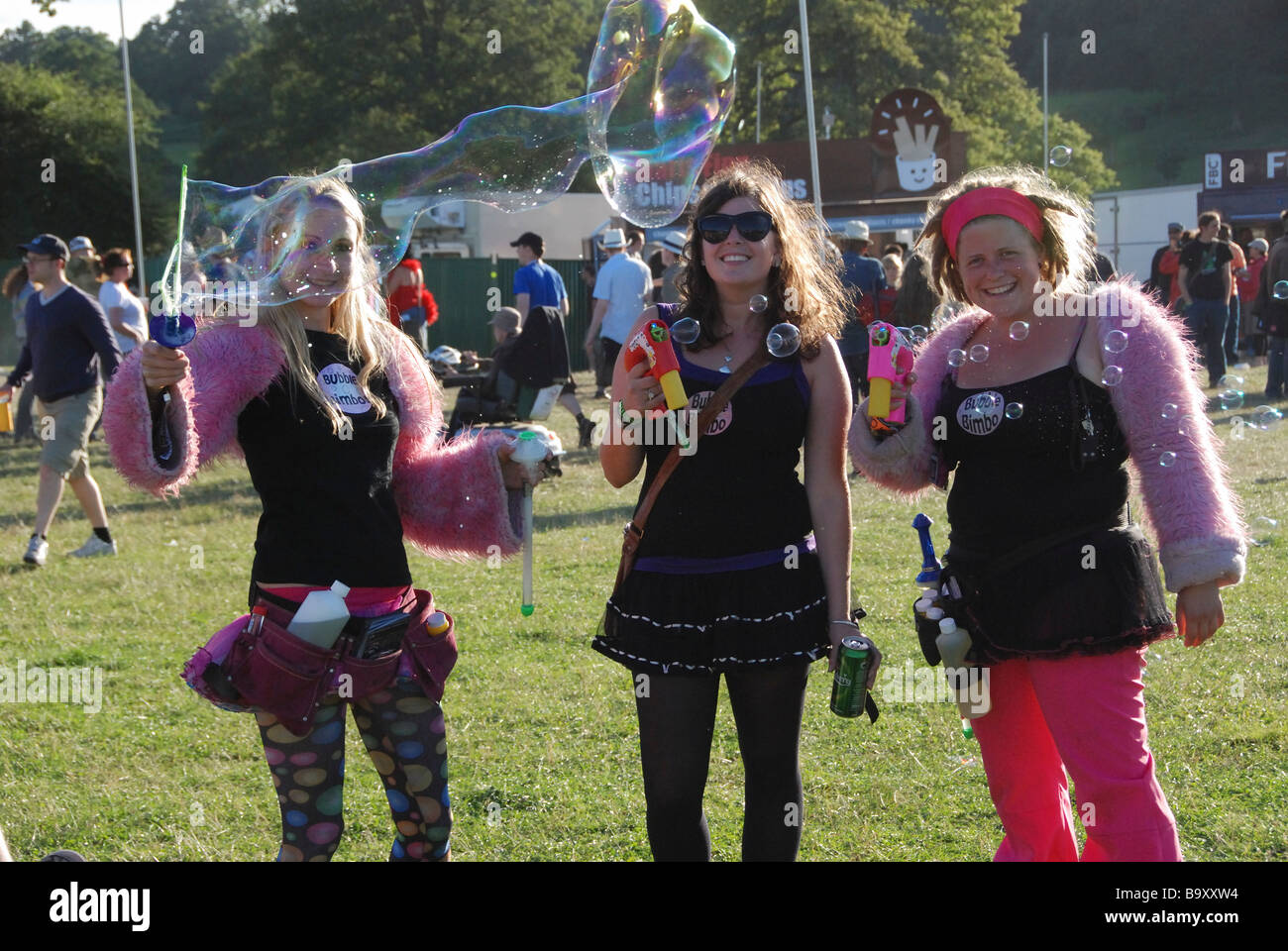 Three girls and huge bubble at Big Chill Music Festival - Stock Image