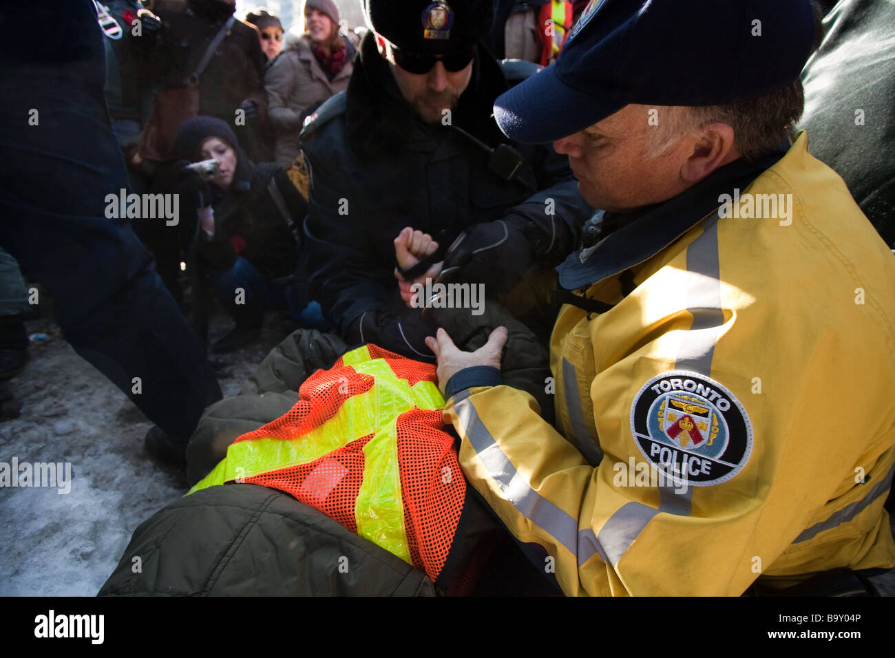 Toronto police arrests a union protester during a CUPE 3903 rally