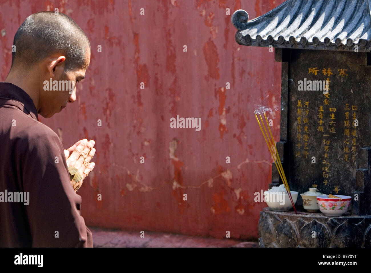 Prayer at the Jade Emperor Pagoda Buddhist temple in Ho Chi Minh City Vietnam - Stock Image