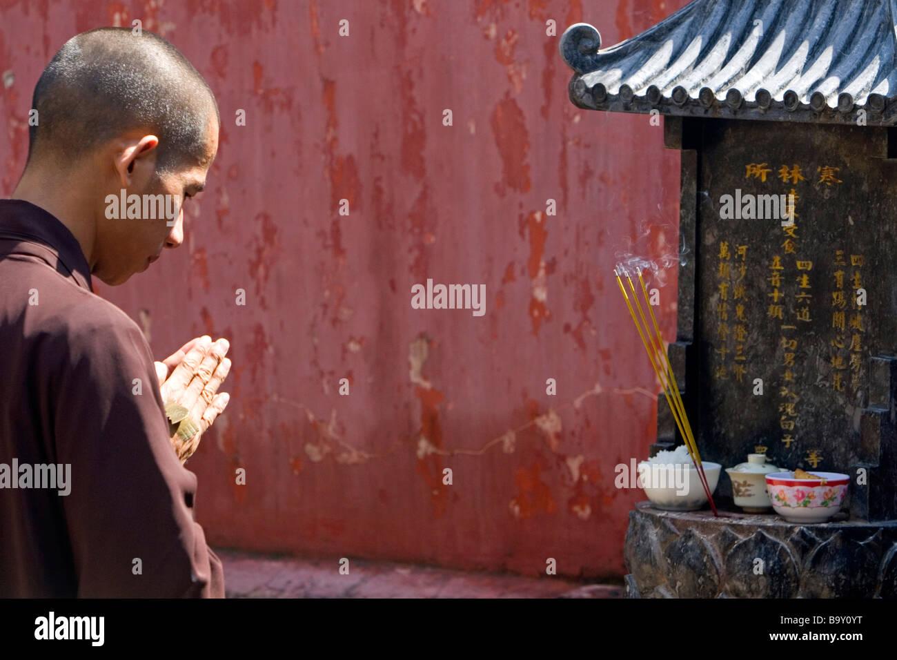 Prayer at the Jade Emperor Pagoda Buddhist temple in Ho Chi Minh City Vietnam Stock Photo