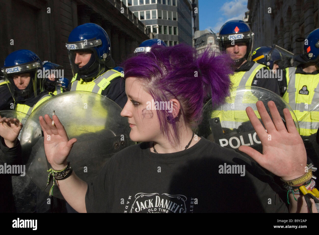 G20 protest. Credit Crunch Stop the City march and demonstration against capitalism. Young punk woman anarchist - Stock Image