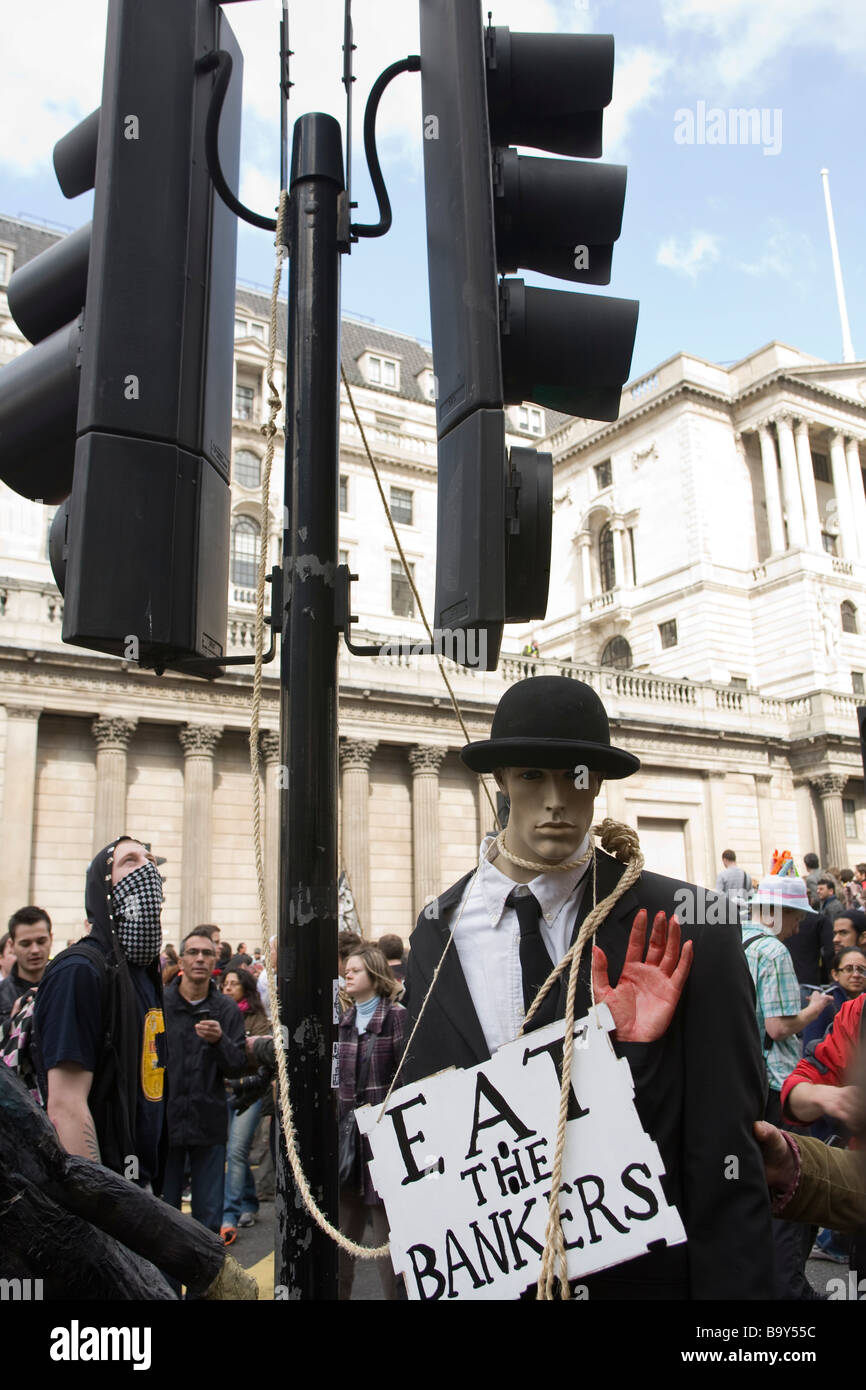 Anarchist protestors staging a mock hanging of a dummy dressed as a banker during anti capitalism protests in The - Stock Image