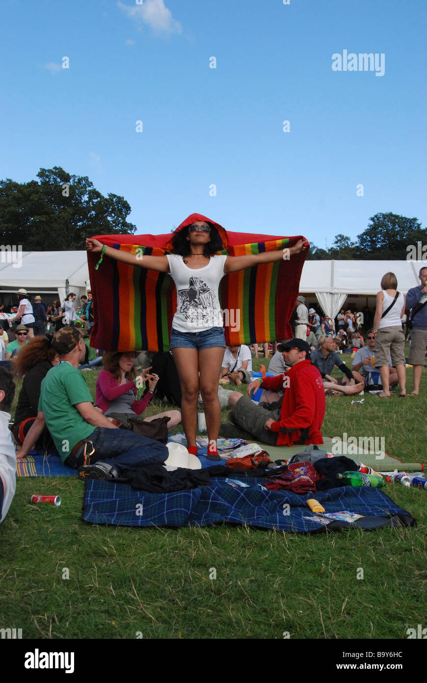 Woman in highly coloured Poncho at Big Chill music fest. - Stock Image