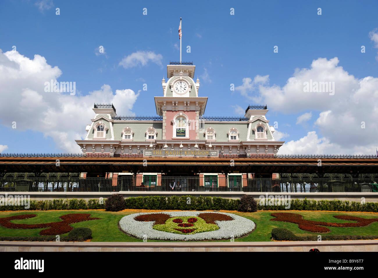Train Station at Entrance to Walt Disney Magic Kingdom Theme Park Orlando Florida Central with Mickey Mouse flower Stock Photo