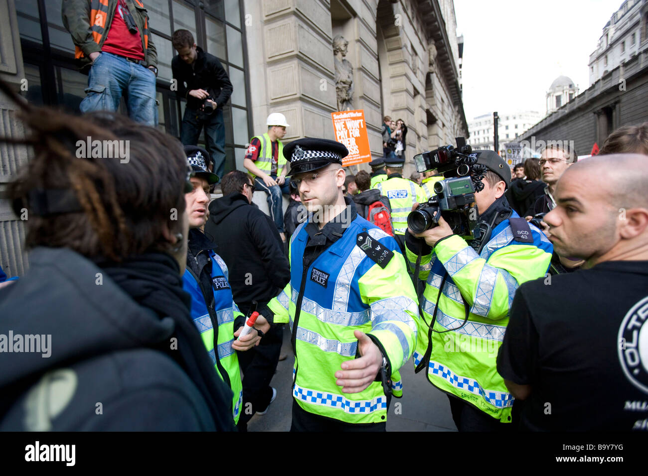 Thousands of protesters marched on the Bank of England in the city of London - Stock Image