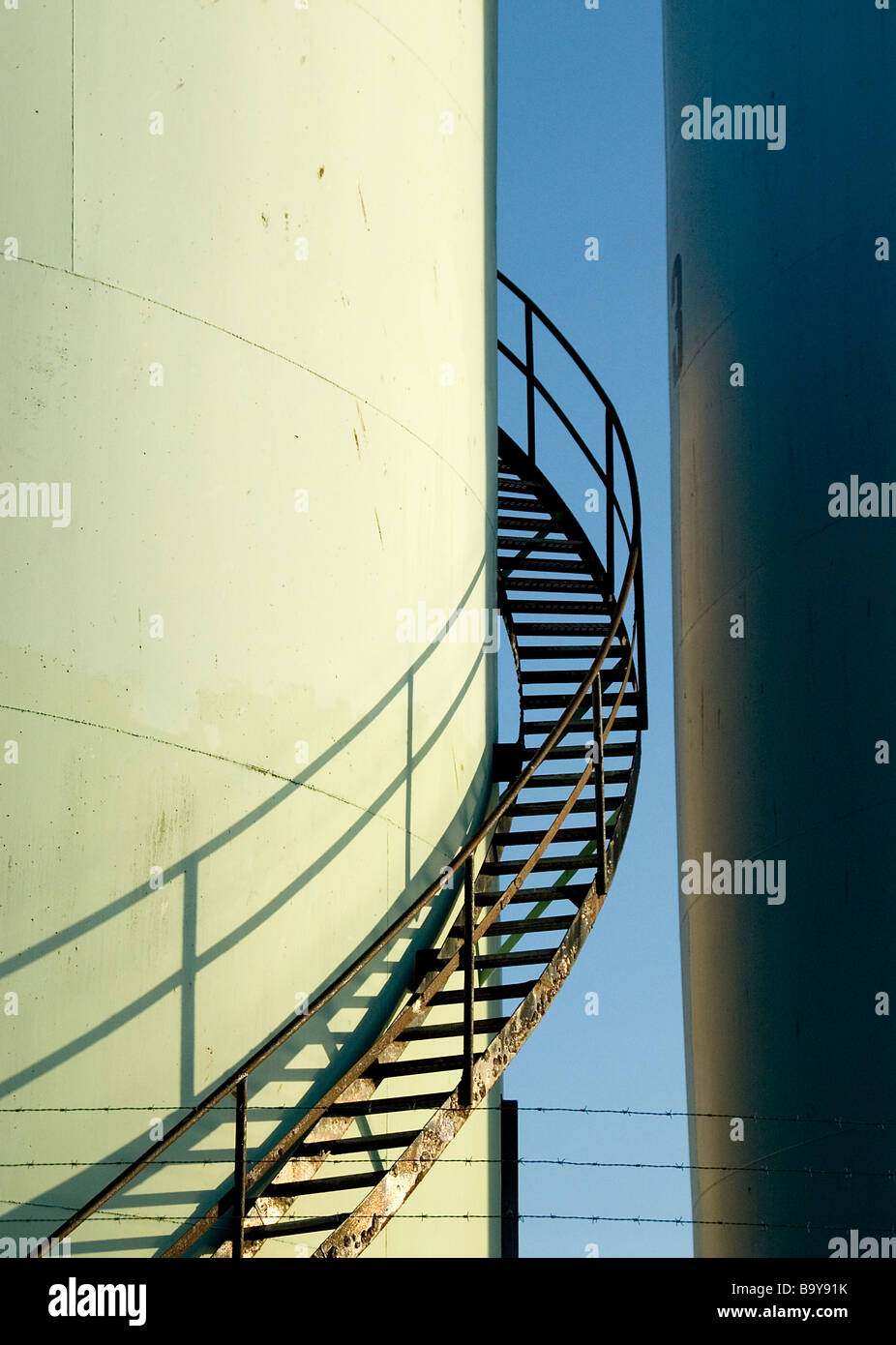 Old rusty curved metal stairway or spindel Stock Photo