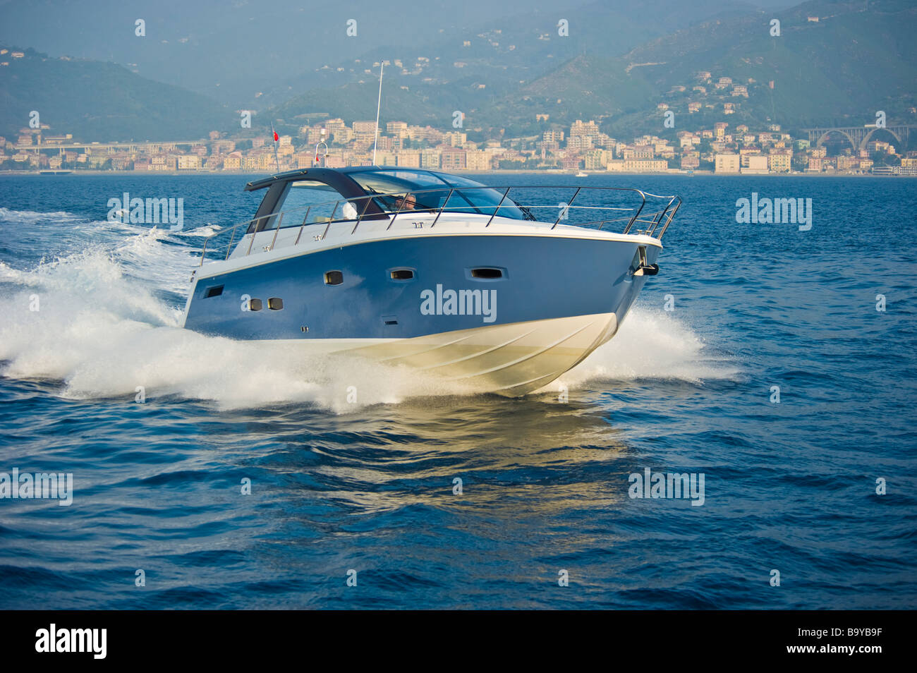 Sealine SC 47 powerboat cruising in the Mediterranean sea in front of the ligurian coast near Genua Italy Sportboot - Stock Image