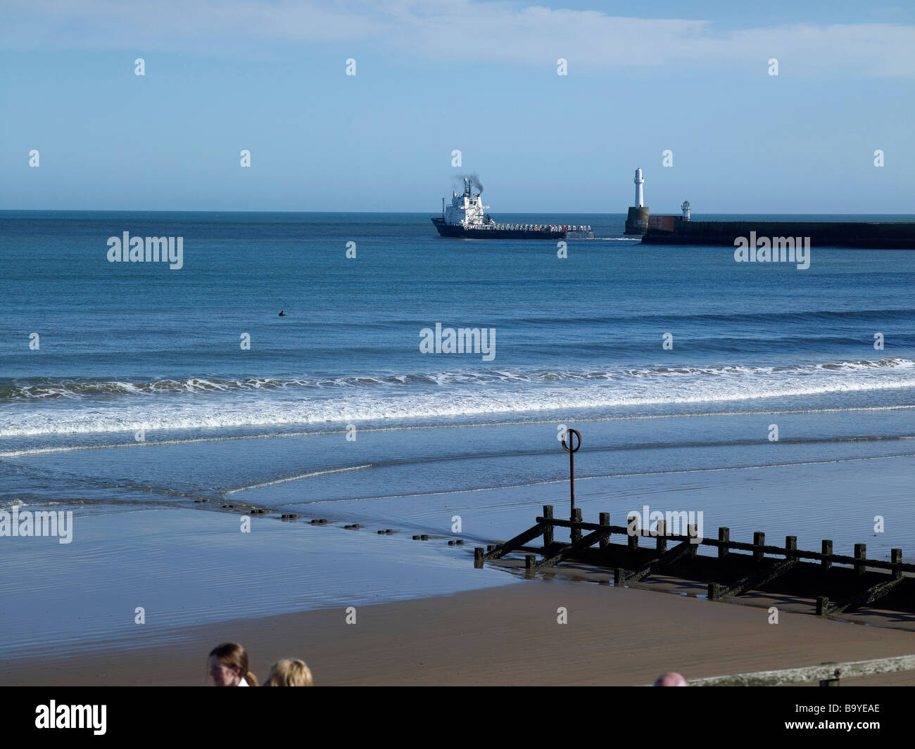 Oil Industry ship leaving the Harbour, from the The Esplanade at Aberdeen, North East Scotland - Stock Image