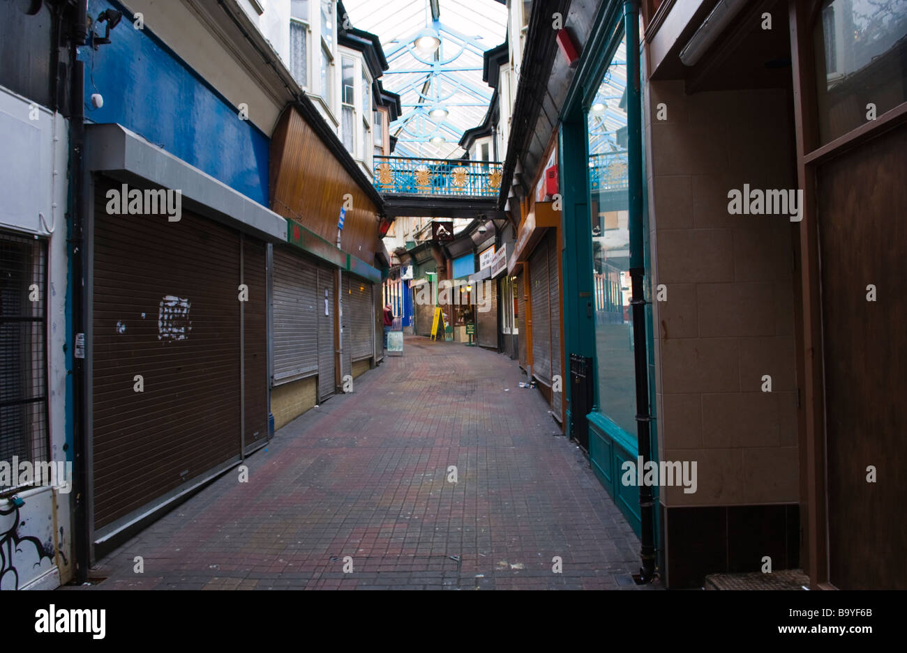 Dingy shopping arcade on a Saturday afternoon Newport South Wales UK - Stock Image