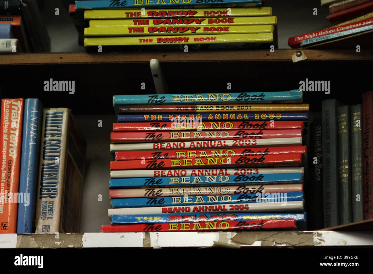 A Stack Of Books On Bookshelf The Beano Anual