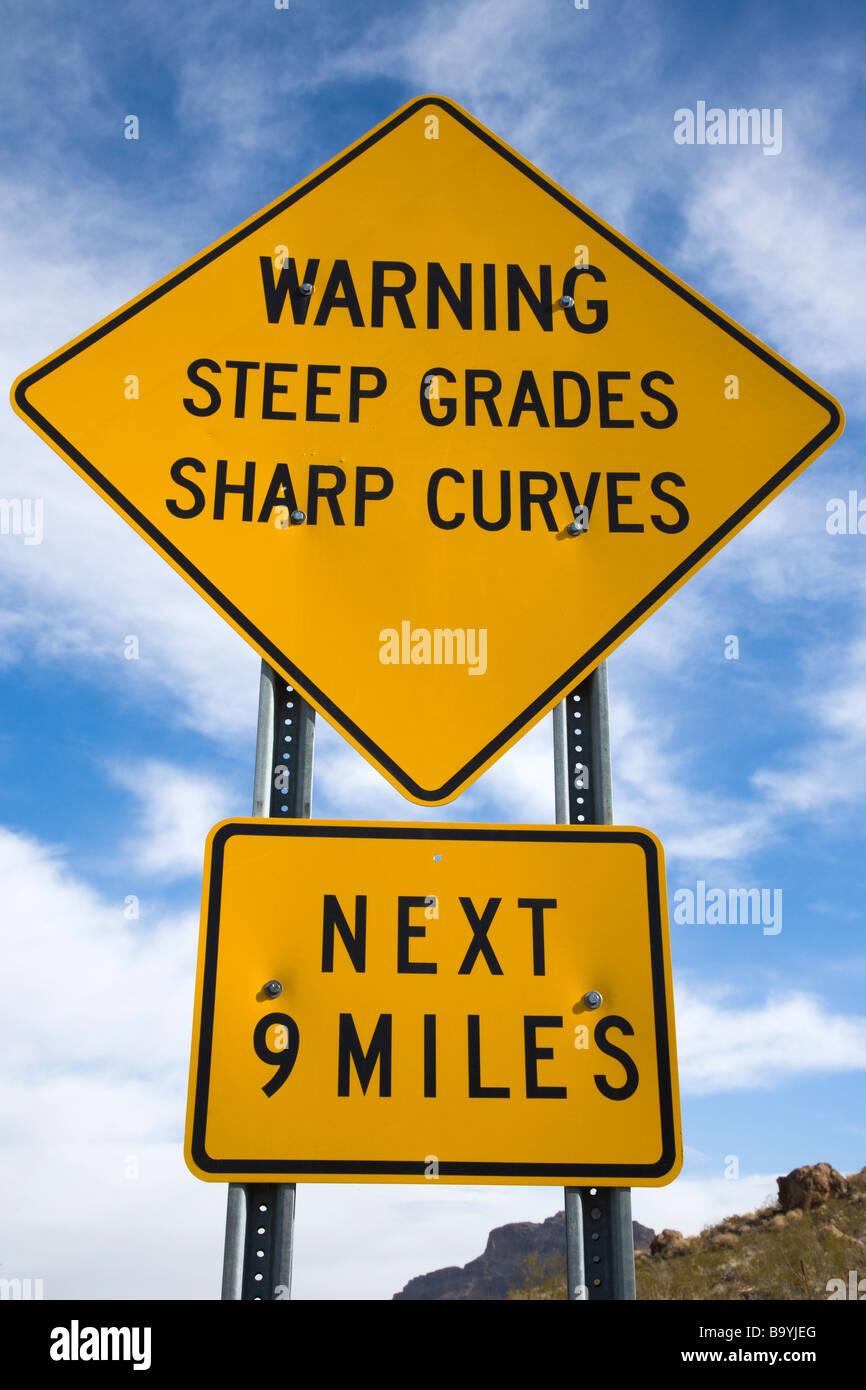 Warning sign steep grades sharp curves Oatman Arizona USA - Stock Image