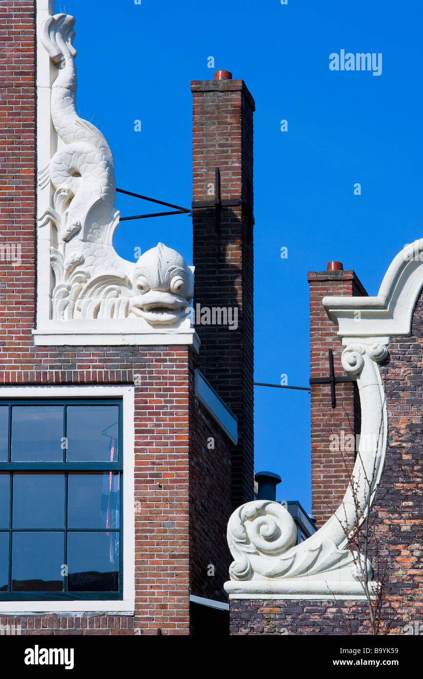 Amsterdam late 17th Century Canal House Gable Roof Top with Dolphin Ornament Brouwersgracht 48 - Stock Image