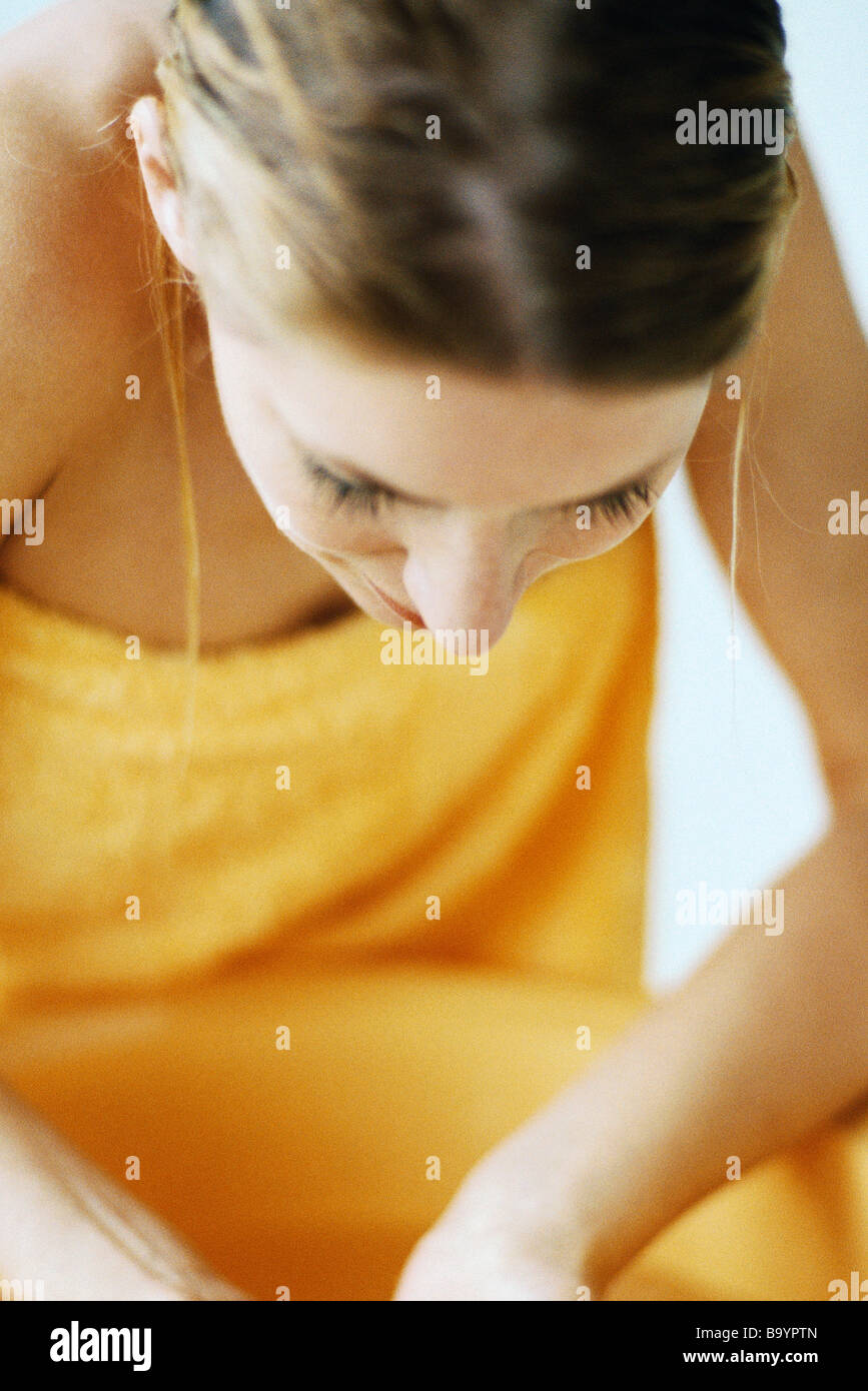 Woman washing face in bathroom sink - Stock Image