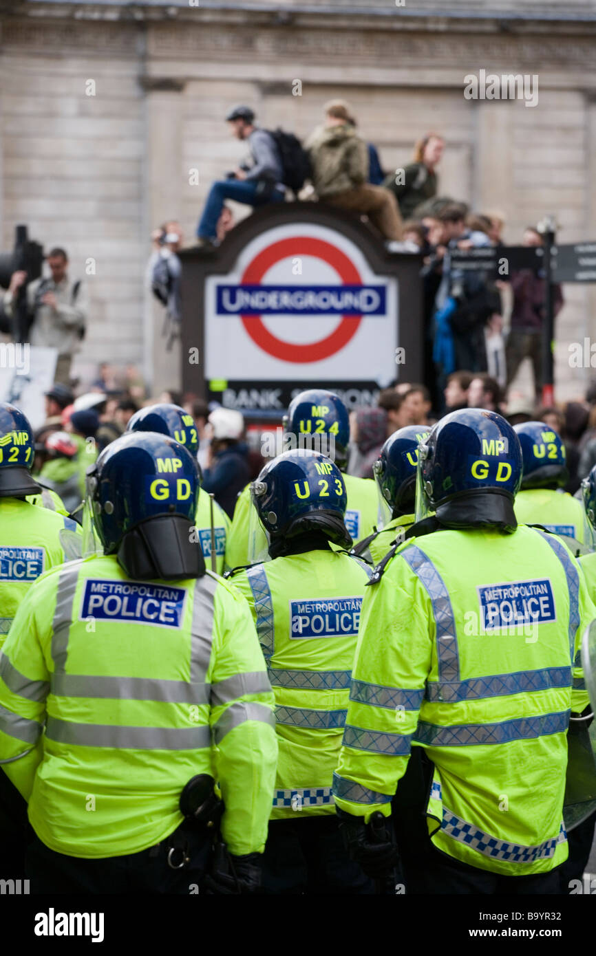 Line of police in partial riot gear during anti-capitalist demonstration against G20 summit in London, April 1 2009 - Stock Image