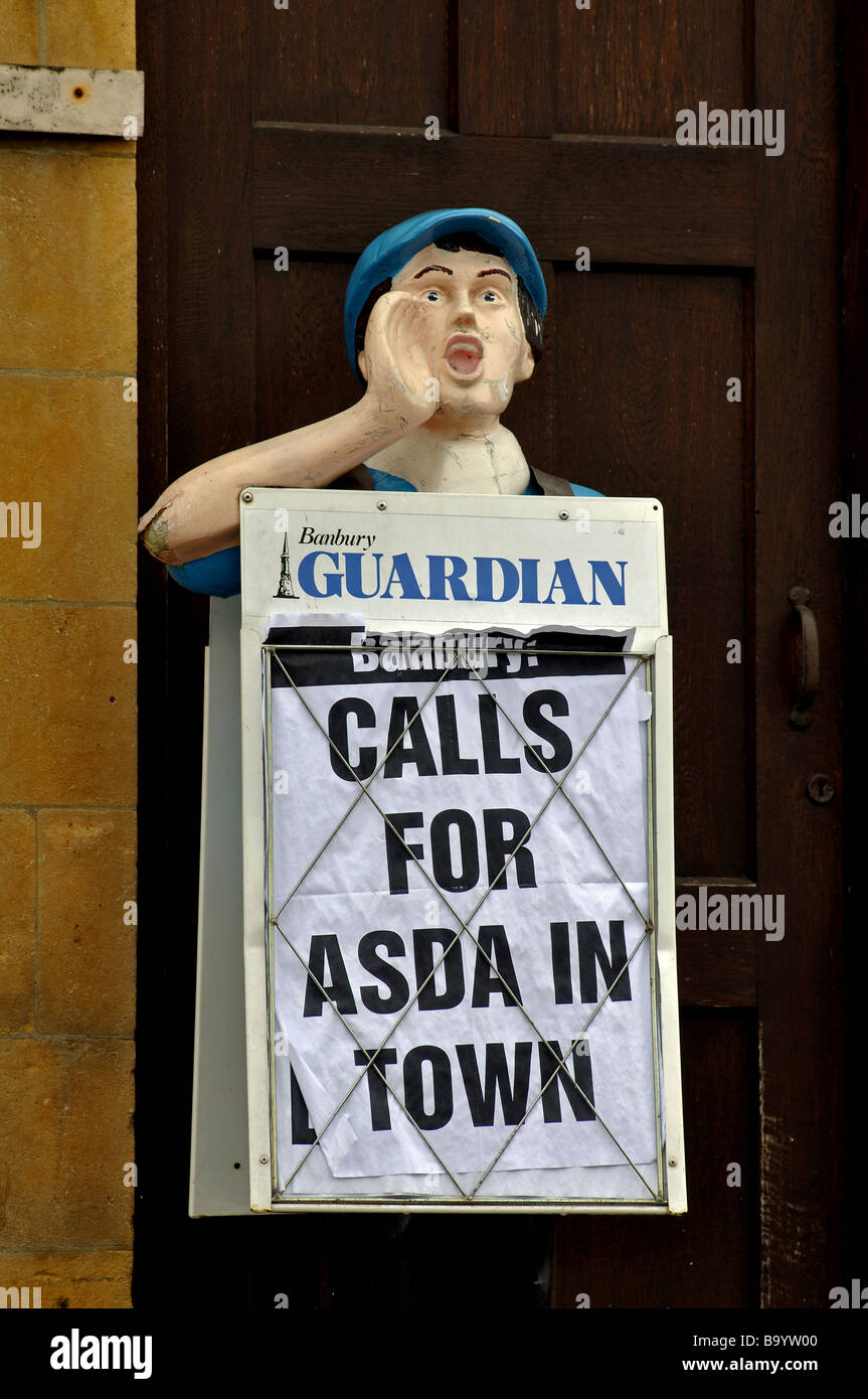 Newspaper board in street, Chipping Norton, Oxfordshire, England, UK - Stock Image