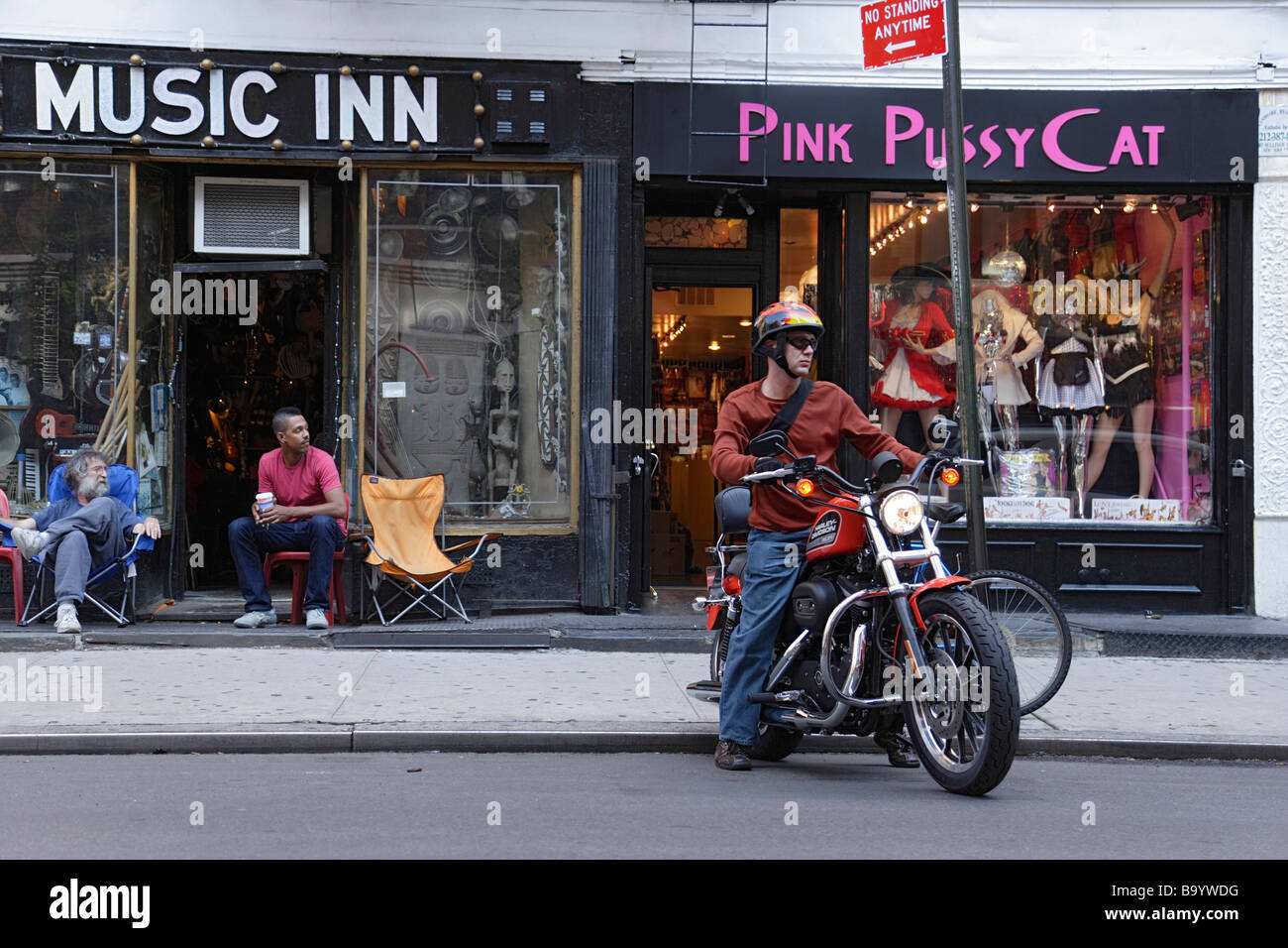 Man riding a bike Greenwich Village Manhattan New York City New York USA - Stock Image