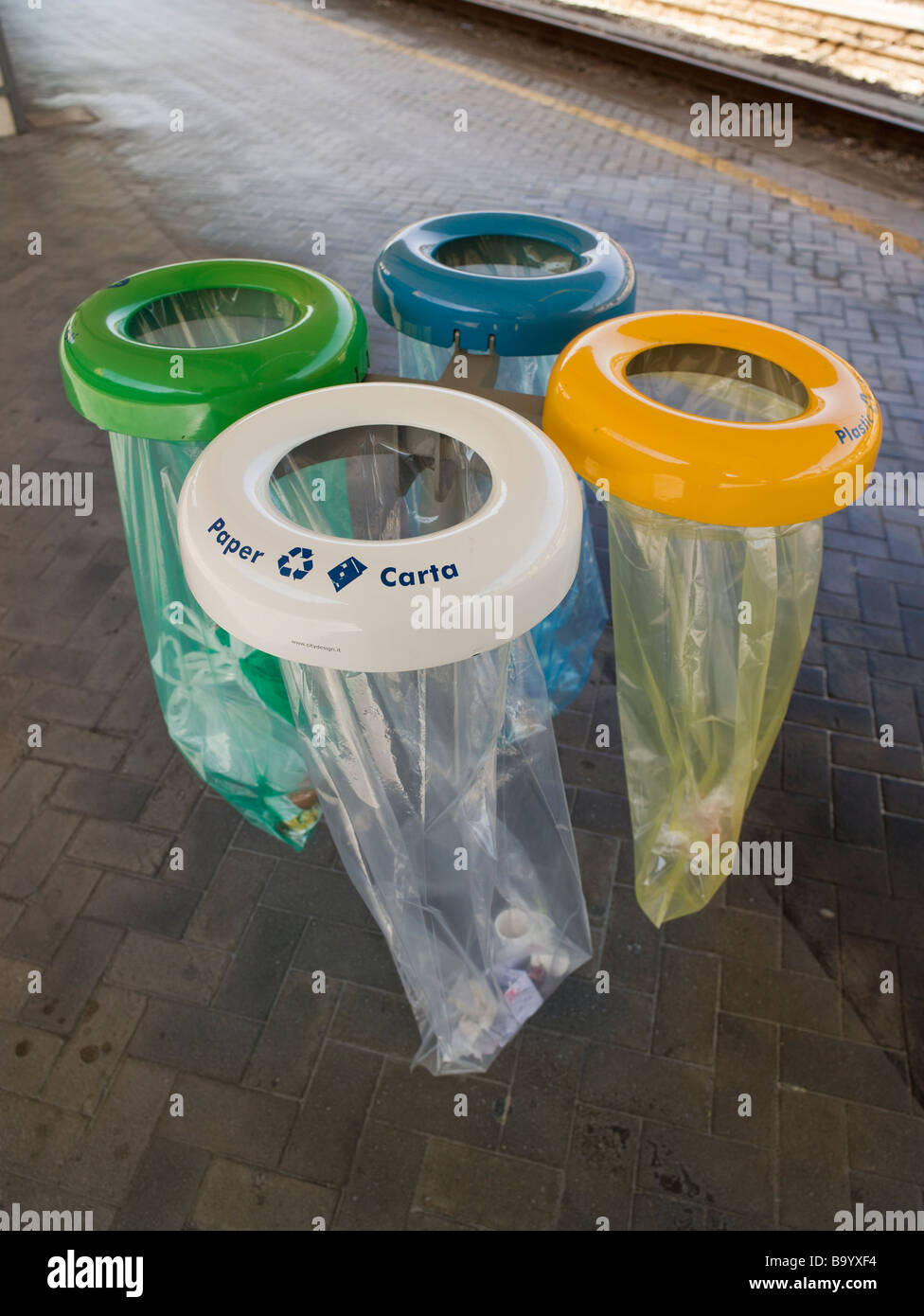 Colour coded recycling bags Bologna Station Italy White for paper yellow for plastic blue for aluminium green for - Stock Image