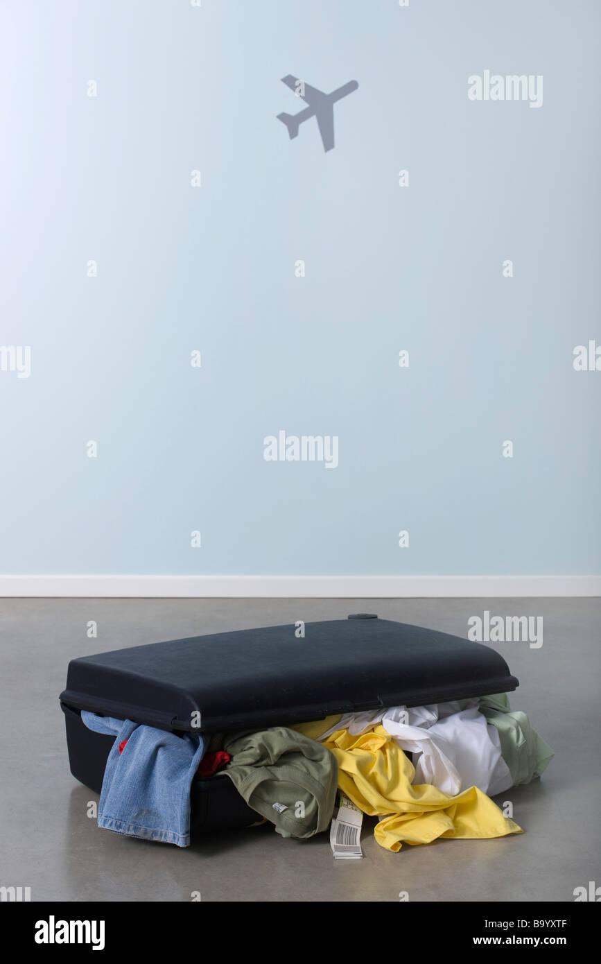 Overstuffed suitcase - Stock Image
