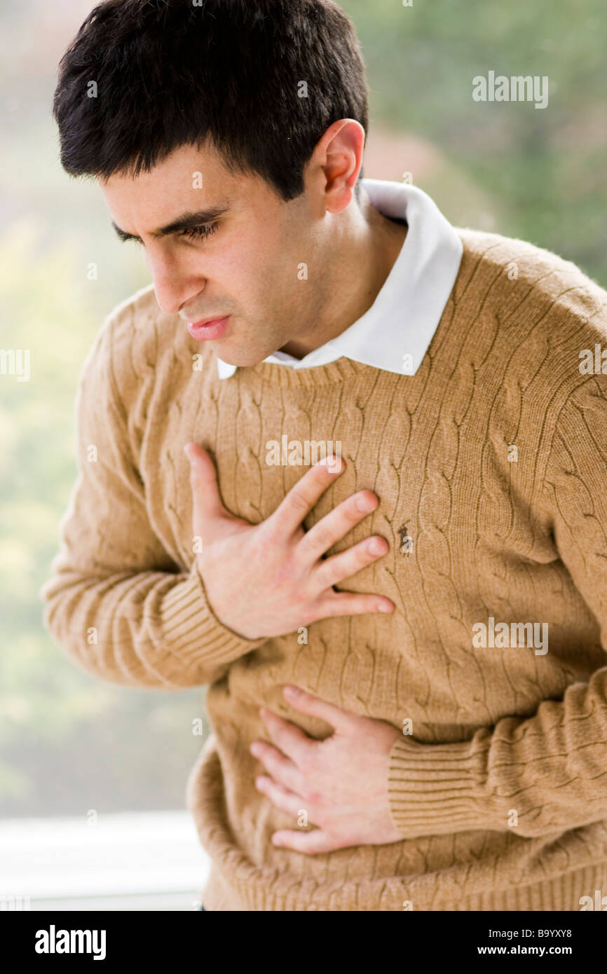Man with indigestion - Stock Image