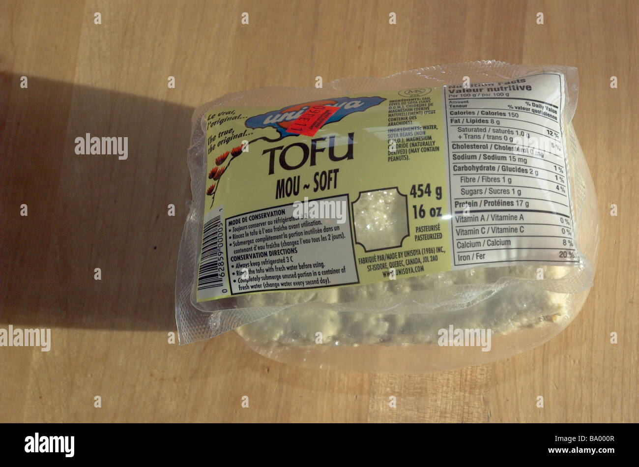 Bad tofu that has inflated its own packet - Stock Image