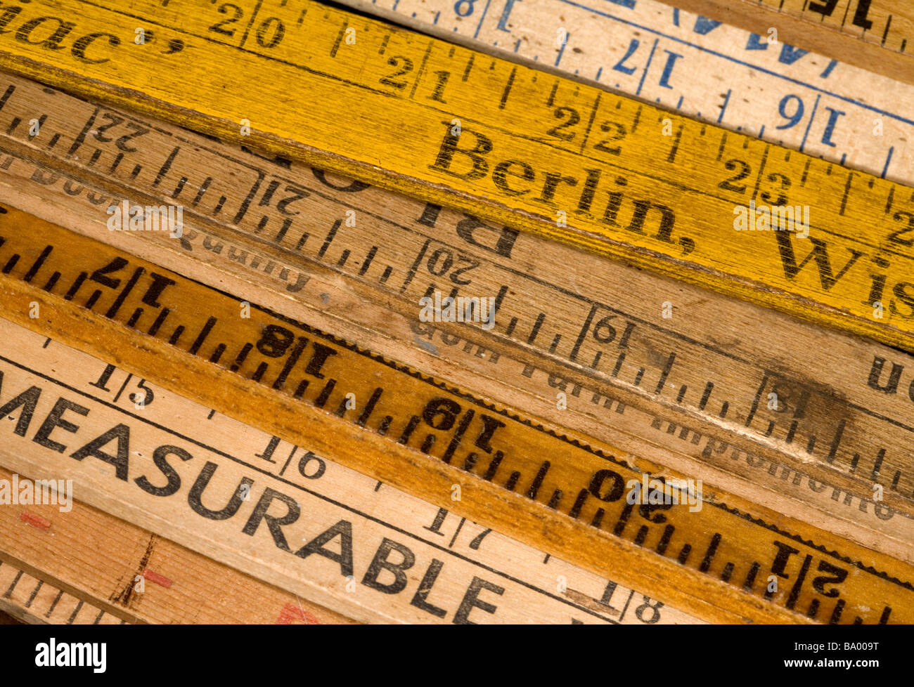 Vintage rulers stacked. - Stock Image