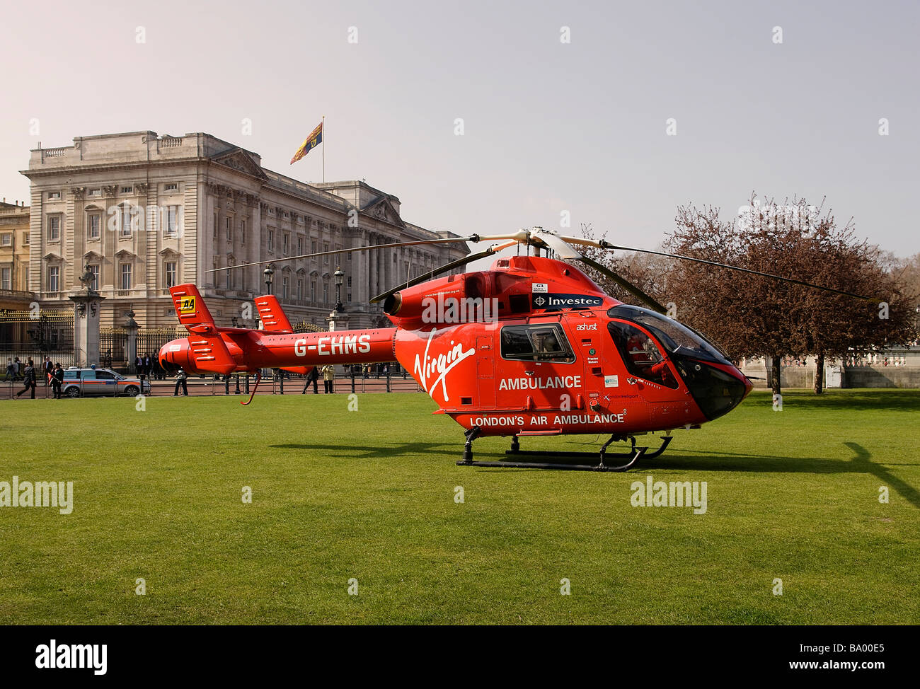 London's Air Ambulance HEMS takes off in front of Buckingham Palace after responding to an emergency - Stock Image