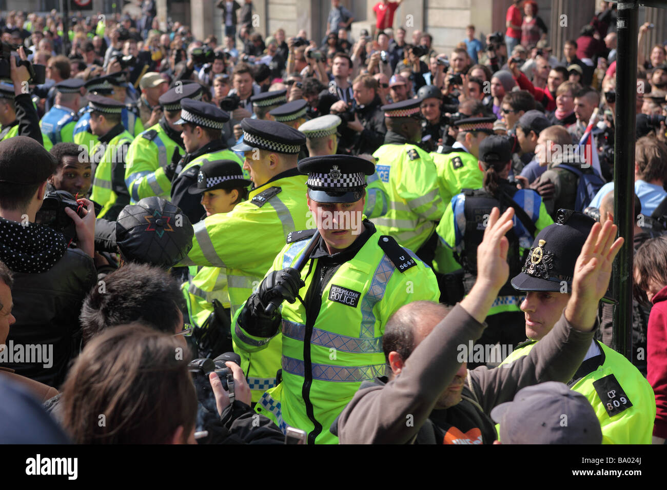 Protesters and police clash outside the Bank of England during the 2009 G20 summit, London, UK. - Stock Image