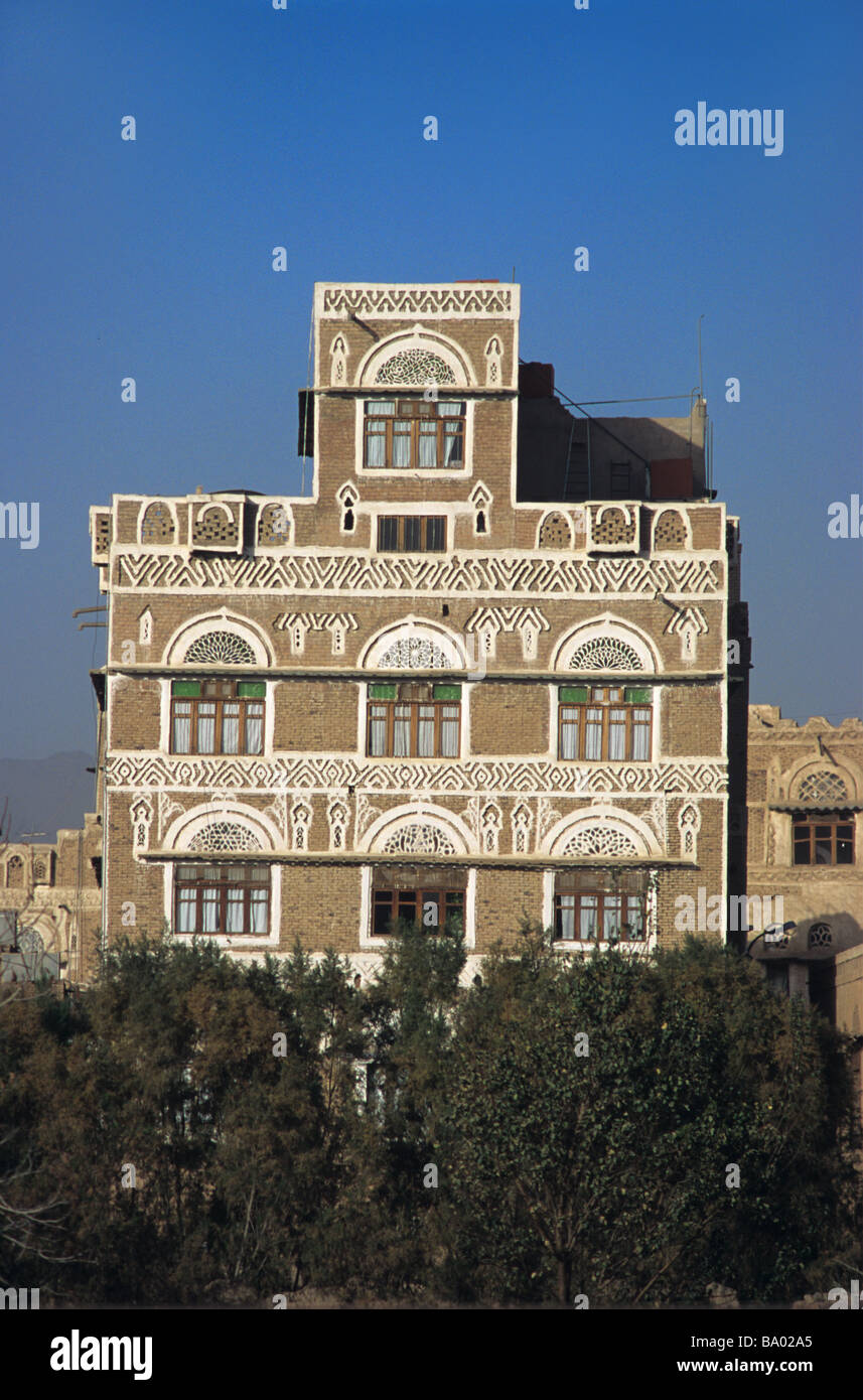Adobe Mud Brick Tower House with Decorated Windows, Sana'a or San'a, Capital of the Republic of Yemen Stock Photo