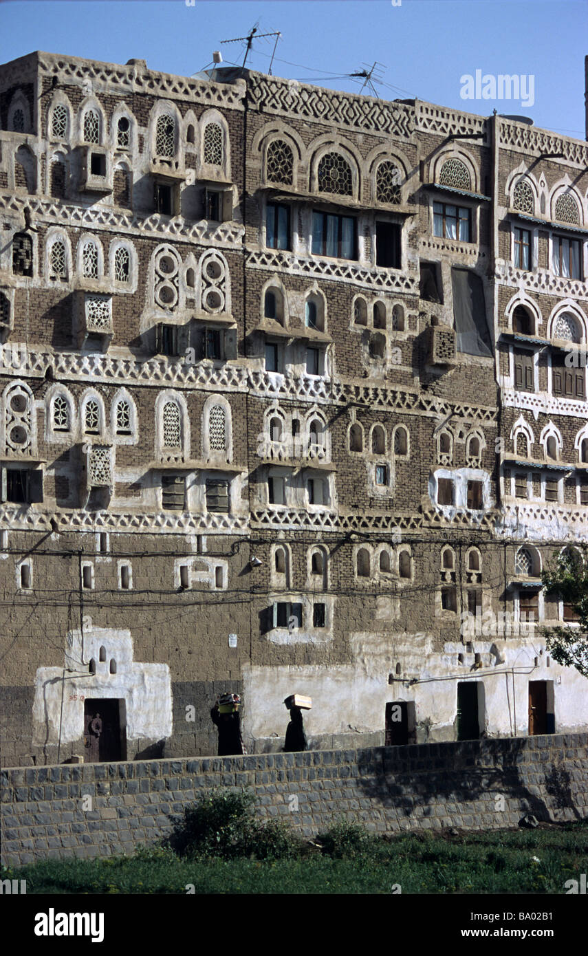 Adobe Mud Brick Tower Houses with Decorated Windows, Sana'a or San'a, Capital of the Republic of Yemen - Stock Image