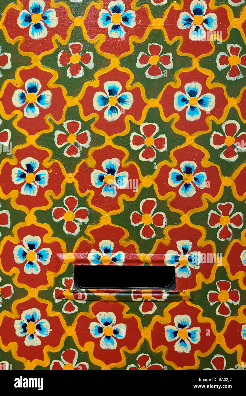 A door covered in a floral design - Stock Image