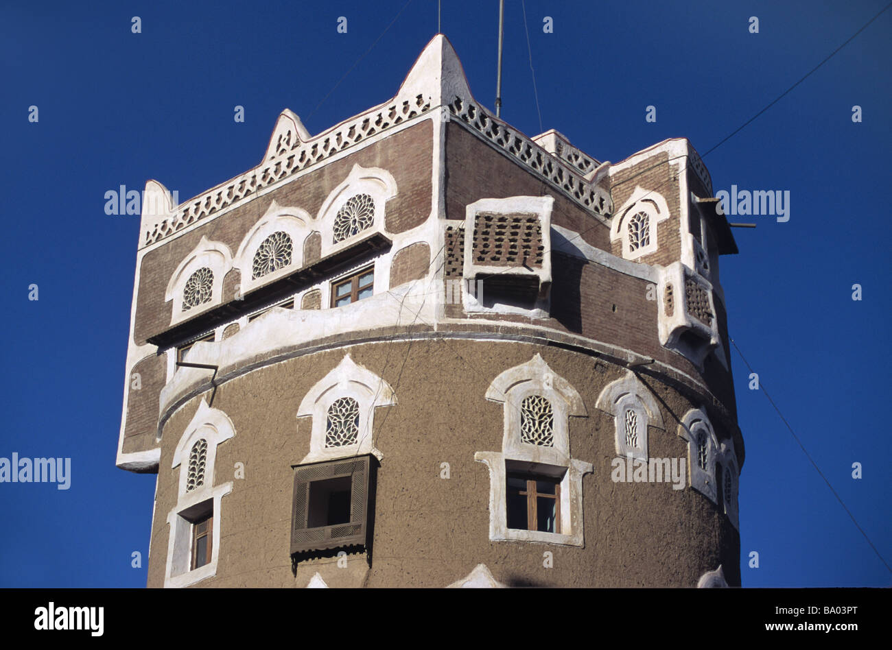 Square Room on Top of Round Adobe Mud Brick Tower House with Decorated Windows, Sana'a or San'a, Capital - Stock Image